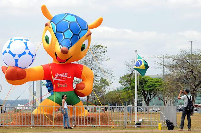 """A inflatable puppet of the FIFA World Cup Brazil 2014 mascot, a """"tatu-bola"""" (armadillo) at Esplanada dos Ministerios in Brasilia, on September 24, 2012. The FIFA is running a contest on the internet to choose the name of the mascot between """"Zuzeco"""", """"Amijubi"""" or """"Fuleco"""". AFP PHOTO/Evaristo SAEVARISTO SA/AFP/GettyImages"""