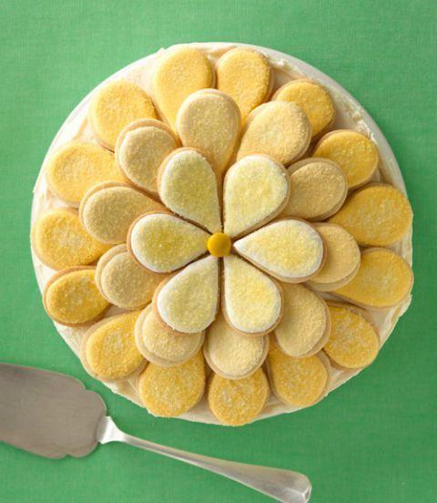 "<p>The ""petals"" of this pretty flower cake are made from individual sugar cookies topped with tangy cream cheese frosting.</p><p><strong><a href=""https://www.womansday.com/food-recipes/food-drinks/recipes/a11896/daisy-cake-recipe/"" rel=""nofollow noopener"" target=""_blank"" data-ylk=""slk:Get the Daisy Cookie Cake recipe."" class=""link rapid-noclick-resp""><em>Get the Daisy Cookie Cake recipe.</em></a></strong></p>"