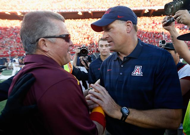 Will the annual rivalry game between Arizona and Arizona State be a make or break game for Todd Graham (L) and Rich Rodriguez? (Getty)