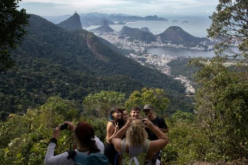 People take photos as they walk along a hiking trail above Rio de Janeiro -- part of a projected 8,000-kilometer trail across Brazil