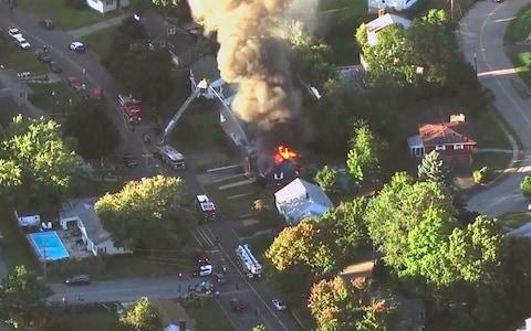 Emergency crews respond to a series of gas explosions that have damaged homes across three communities north of Boston - Credit: WCVB