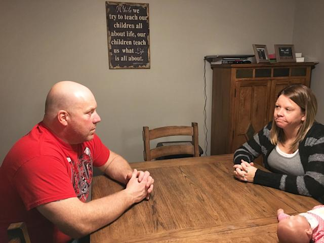 Tracy and Danielle Lammers, sitting in their dining room two weeks after learning Medi-ShareconsideredDanielle's cancer a pre-existing condition and rejected payment for treatment. Medi-Share later reversed its decision, following their appeal.