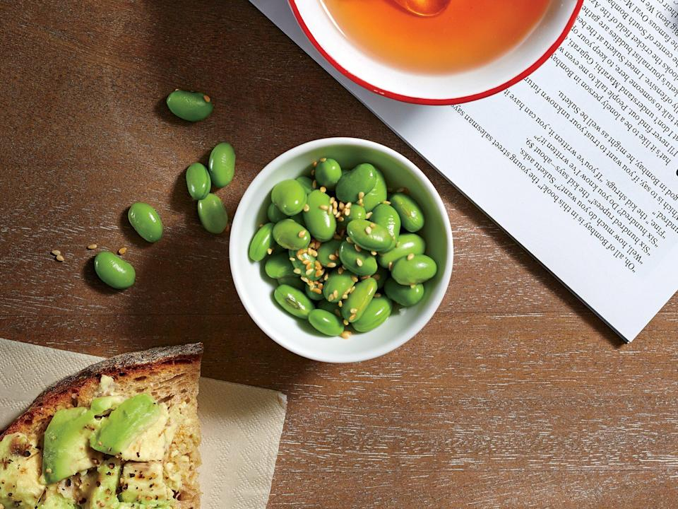 """<p>For the late-night munchies, try Edamame Crunch. This snack packs in 8g of protein in a half-cup serving. Try this staff favorite sautéed or roasted, too.</p> <p><a href=""""https://www.myrecipes.com/recipe/edamame-crunch"""" rel=""""nofollow noopener"""" target=""""_blank"""" data-ylk=""""slk:Edamame Crunch Recipe"""" class=""""link rapid-noclick-resp"""">Edamame Crunch Recipe</a></p>"""
