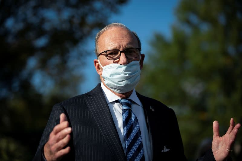 White House chief economic adviser Larry Kudlow speaks to reporters following a television interview, outside the White House i