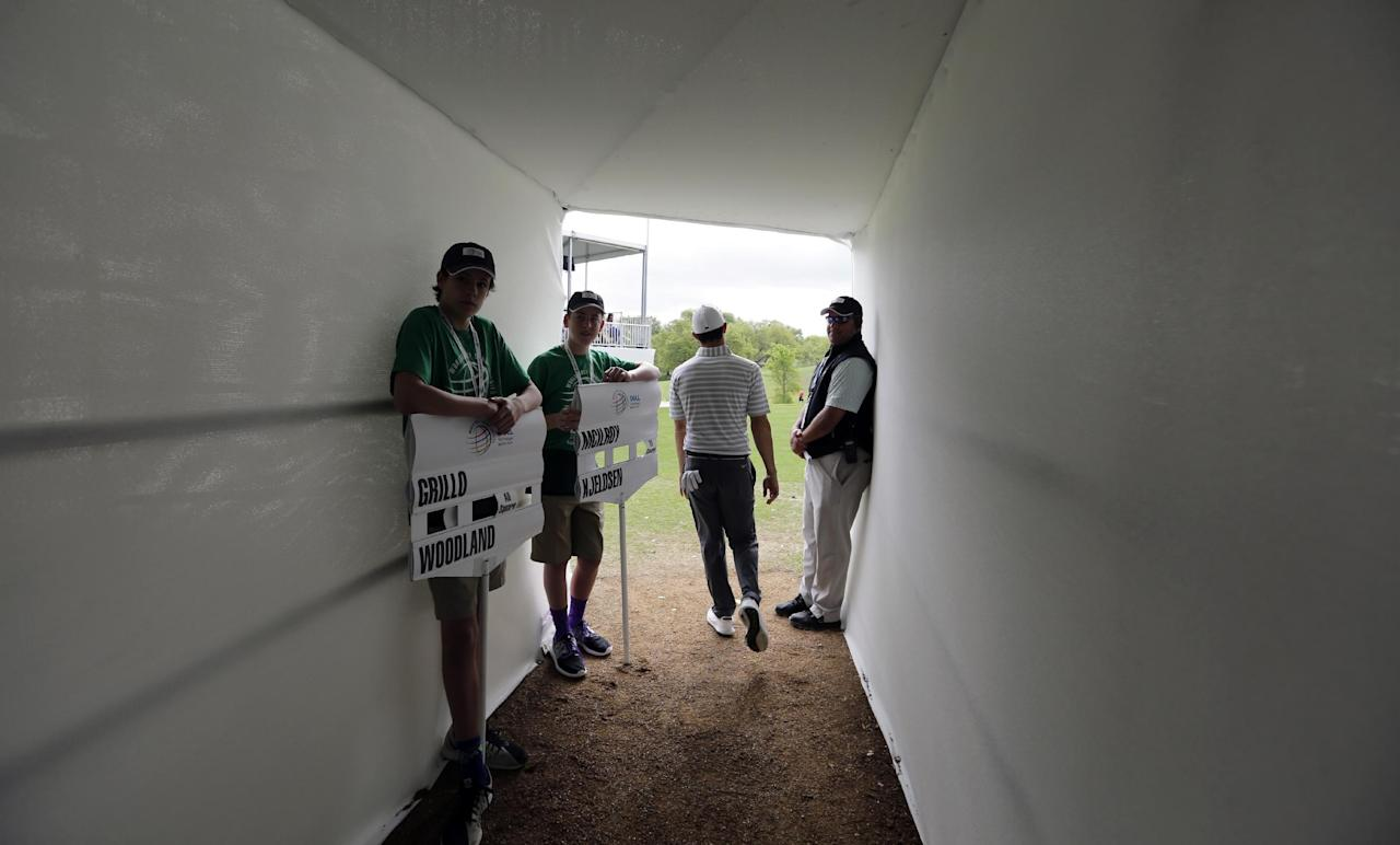 Rory McIlroy, of Northern Ireland, walks through a tunnel to the first hole during round-robin play against Soren Kjeldsen, of Denmark, at the Dell Technologies Match Play golf tournament at Austin County Club, Wednesday, March 22, 2017, in Austin, Texas. (AP Photo/Eric Gay)