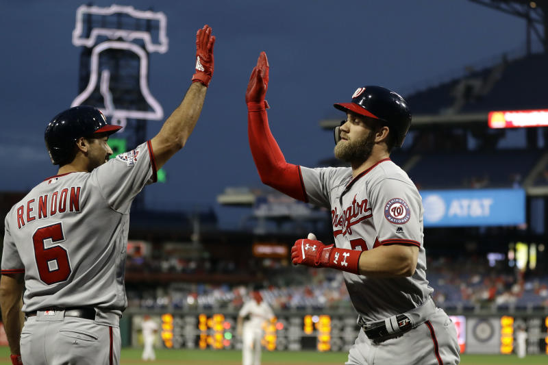 Bryce Harper (right) has reportedly failed to play in Philadelphia. (AP)
