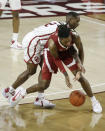Alabama's John Petty Jr., front, keeps the ball from Oklahoma's Umoja Gibson (2) during the second half of an NCAA college basketball game in Norman, Okla., Saturday, Jan. 30, 2021. (AP Photo/Garett Fisbeck)
