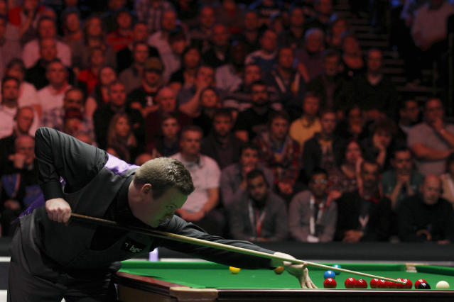 Shaun Murphy of England lines up a shot during a frame against Australia's Neil Robertson during the final of the BGC masters snooker tournament at Alexandra Palace in London, on January 22, 2012. AFP PHOTO / JUSTIN TALLIS (Photo credit should read JUSTIN TALLIS/AFP/Getty Images)