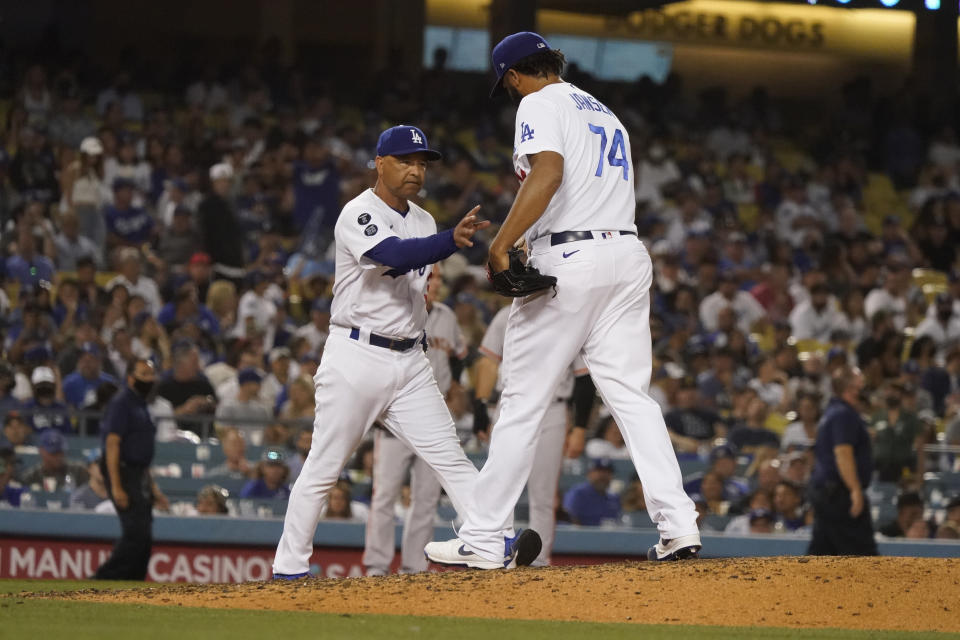 Los Angeles Dodgers relief pitcher Kenley Jansen (74) is removed by manager Dave Roberts during the ninth inning of the team's baseball game against the San Francisco Giants on Wednesday, July 21, 2021, in Los Angeles. (AP Photo/Marcio Jose Sanchez)