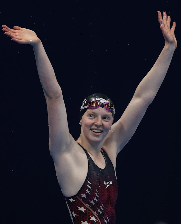 Lydia Jacoby is pictured waving to spectators after winning gold in the 100 meter breastroke final at the Tokyo Olympics.