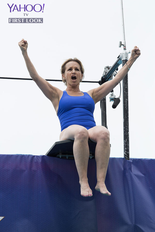 <p>Carteris (<em>Beverly Hills, 90210</em>) raises her arms and roars as she prepares to slide.<br /><br />(Photo Credit: Kelsey McNeal/ABC) </p>