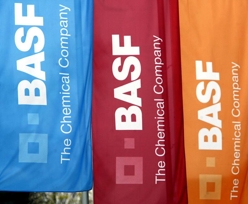 FILE - In this April 19, 2004 file picture flags with the  BASF-Logo  fly in Schwarzheide Germany. Chemical company BASF  said Thursday July 28, 2011,  its ability to raise prices helped boost net profits 22 percent in the second quarter from a year ago, but that its sales growth would slow in the second half of the year.  BASF's shares dropped sharply Thursday as profits fell short of stock market predictions and the company warned over its second half prospects. (AP Photo/dapd/ Miguel Villagran,File)