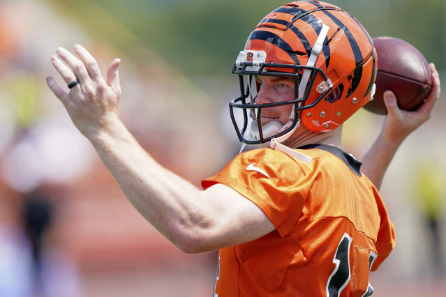 Cincinnati Bengal quarterback Andy Dalton throws a pass during the first day of NFL football training camp Saturday, July 27, 2019, in Dayton, Ohio. (AP Photo/Bryan Woolston)