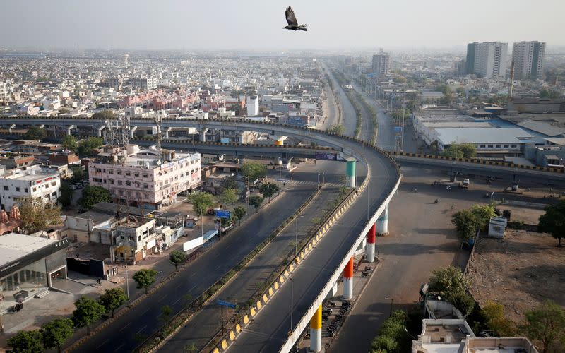 FILE PHOTO: A view shows empty roads during a 14-hour long curfew to limit the spreading of coronavirus disease (COVID-19) in the country, in Ahmedabad