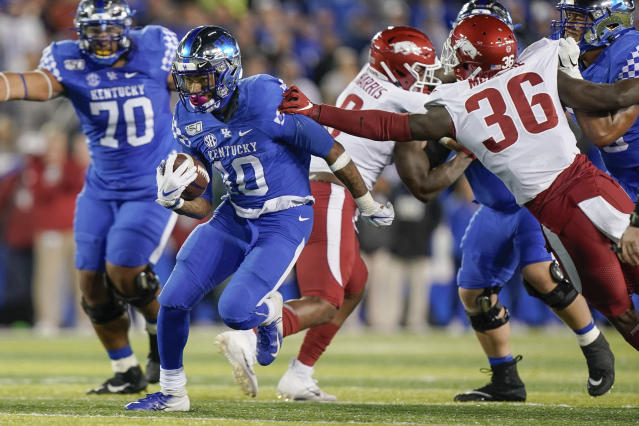 Kentucky running back Asim Rose (10) runs with the ball during the second half of the team' NCAA college football game against Arkansas, Saturday, Oct. 12, 2019, in Lexington, Ky. (AP Photo/Bryan Woolston)