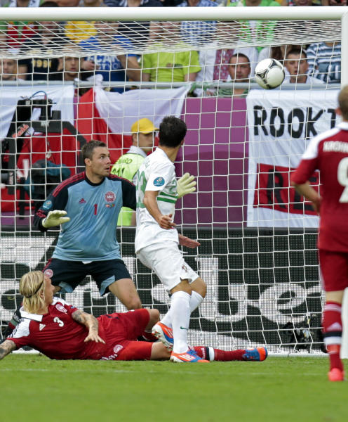 Portugal's Helder Postiga, center, scores his side's second goal during the Euro 2012 soccer championship Group B match between Denmark and Portugal in Lviv, Ukraine, Wednesday, June 13, 2012. (AP Photo/Ivan Sekretarev)