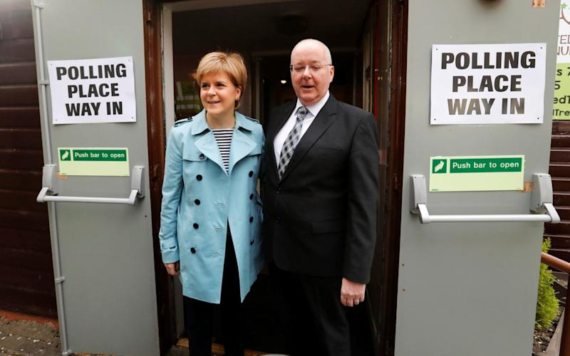 Nicola Sturgeon and her husband Peter Murrell arrive to vote in local elections at a polling station in Glasgow - Credit: Reuters