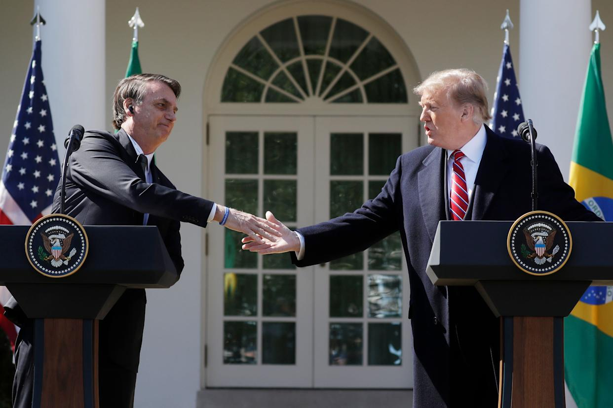 """""""Brazil's relationship with the United States, because of our friendship, is probably better than it's ever been,"""" President Donald Trump (right) said during a meeting with Brazil President Jair Bolsonaro at the White House on Tuesday. (Photo: HuffPost Brasil)"""