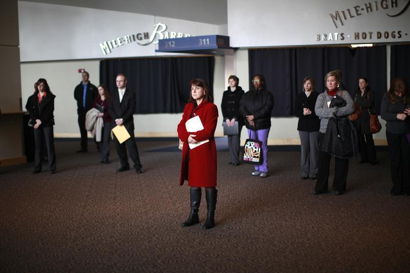 Job seekers listen to a presentation at the Colorado Hospital Association health care career fair in Denver