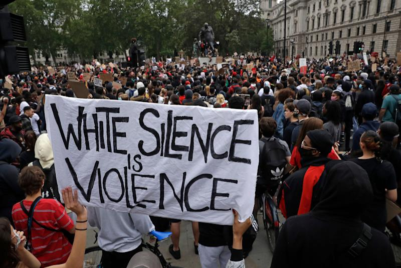 Protesters gather during a demonstration in Parliament Square in London (Photo: ASSOCIATED PRESS)