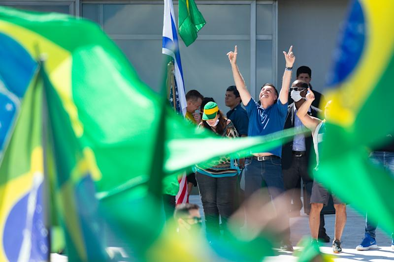 BRASILIA, BRAZIL - MAY 03: Brazilian President Jair Bolsonaro participates in a protest against the National Congress and the Supreme Court amidston the coronavirus (COVID-19) pandemic at the Planalto Palace on May 03, 2020 in Brasilia. Brazil has over 96,000 confirmed positive cases of coronavirus and 6,750 deaths. (Photo by Andressa Anholete/Getty Images)