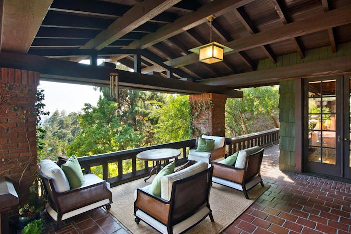 <p>You can easily lose a century while relaxing on one of several spacious Arts and Crafts porches.</p>