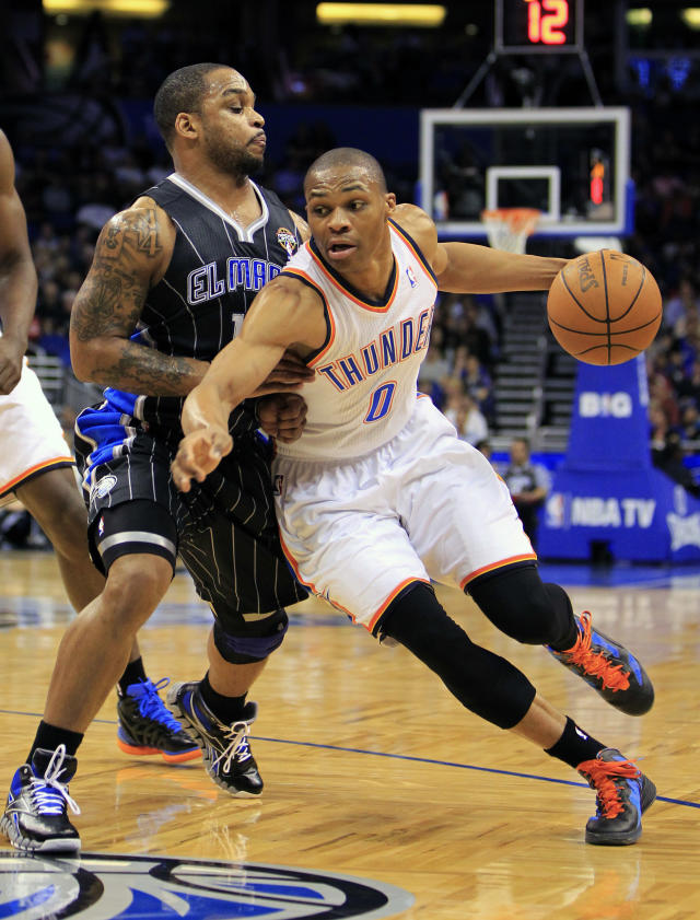 Oklahoma City Thunder's Russell Westbrook (0) drives around Orlando Magic's Jameer Nelson during the first half of an NBA basketball game on Thursday, March 1, 2012, in Orlando, Fla. (AP Photo/John Raoux)