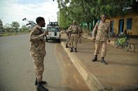 Members of Amhara Special Forces stand guard along a street in Humera town