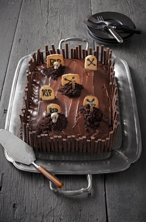 """<p>The key to this mini-cemetery: tombstones fashioned from Pepperidge Farm's Milano and Bordeaux cookies.</p><p>To decorate the tombstones, fill a resealable plastic bag with chocolate frosting, seal the bag, and snip off a tiny corner.</p><p>Pipe <em>RIP</em> or <em>X</em> on the upper half of each cookie. Push the cookies into the cake (as shown) and pile crushed chocolate wafers in front of a few to conjure dirt mounds.</p><p>Trim the perimeter of the cake with a fence of Rademaker chocolate sticks, cut to various heights.</p><p>Finally, separate and insert pieces of small plastic skeletons into the cookie-crumb dirt. </p><p><strong><a href=""""https://www.countryliving.com/food-drinks/recipes/a37728/rich-chocolate-frosting-recipe/"""" rel=""""nofollow noopener"""" target=""""_blank"""" data-ylk=""""slk:Get recipe for chocolate frosting"""" class=""""link rapid-noclick-resp"""">Get recipe for chocolate frosting</a>.</strong></p>"""