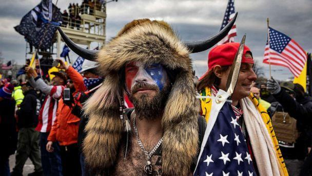 PHOTO: Jacob Anthony Angeli Chansley, known as the QAnon Shaman, is seen outside the Capital building on Jan. 6, 2021, in Washington. On Jan. 9, Chansley was arrested on federal charges including violent entry and disorderly conduct on Capitol grounds. (Brent Stirton/Getty Images, FILE)