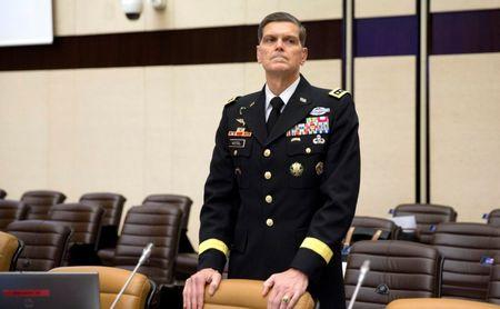 General Votel waits for the start of a round table meeting at NATO headquarters in Brussels