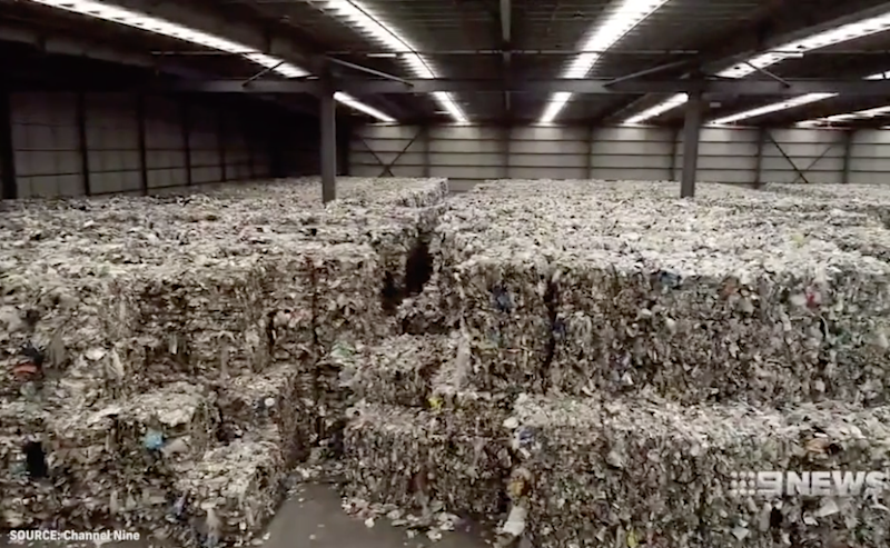 Tonnes of recyclables are seen in a warehouse in Derrimut, Victoria.