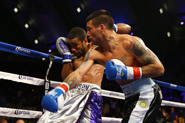ATLANTIC CITY, NJ - MAY 18: Lucas Matthysse punches Lamont Peterson in the third round on his way to a TKO win during their Welterweight fight at Boardwalk Hall Arena on May 18, 2013 in Atlantic City, New Jersey. (Photo by Al Bello/Getty Images)