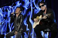 """FILE - In this Aug. 6, 2013 file photo, Arnel Pineda, left, and Neal Schon of the rock band Journey perform onstage following a panel discussion on the Independent Lens documentary """"Don't Stop Believin': Everyman's Journey,"""" at the PBS Summer 2013 TCA press tour at the Beverly Hilton Hotel in Beverly Hills, Calif. The late rapper Tupac Shakur and Seattle-based rockers Pearl Jam lead a class of Rock and Roll Hall of Fame inductees that also include folkie Joan Baez and 1970s favorites Journey, Yes and Electric Light Orchestra. The hall's 32nd annual induction ceremony will take place on April 7, 2016, at Barclays Center in Brooklyn, N.Y. (Photo by Chris Pizzello/Invision/AP, File)"""