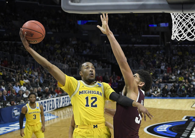 Michigan guard Muhammad-Ali Abdur-Rahkman (12) shoots against Texas A&M during the first half of an NCAA men's college basketball tournament regional semifinal Thursday, March 22, 2018, in Los Angeles. (AP Photo/Jae Hong)