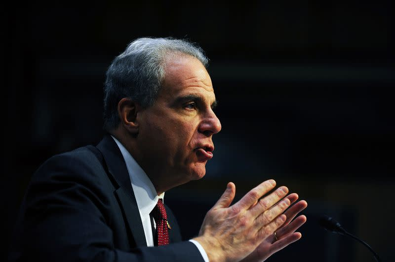 FILE PHOTO:  U.S. Justice Department Inspector General Michael Horowitz testifies before a Senate Judiciary hearing on his report on alleged abuses of the Foreign Intelligence Surveillance Act in the Hart Senate office building in Washington