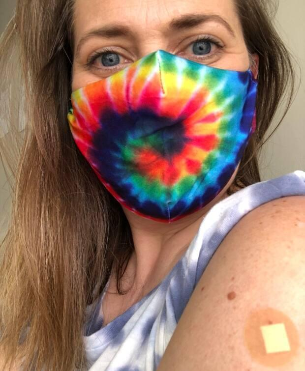 Betsy Hilton, 42, posted this photo of herself on Twitter after getting the first dose of AstraZeneca and said in a tweet: 'Huge thanks to science. To #AstraZenaca. To the healthcare community. And to my awesome local pharmacy.' She added: 'Walking to the pharmacy, listening to Beastie Boys 'Sure Shot'. #vaxjam #AstraZenaca #GenX' (Submitted by Betsy Hilton - image credit)