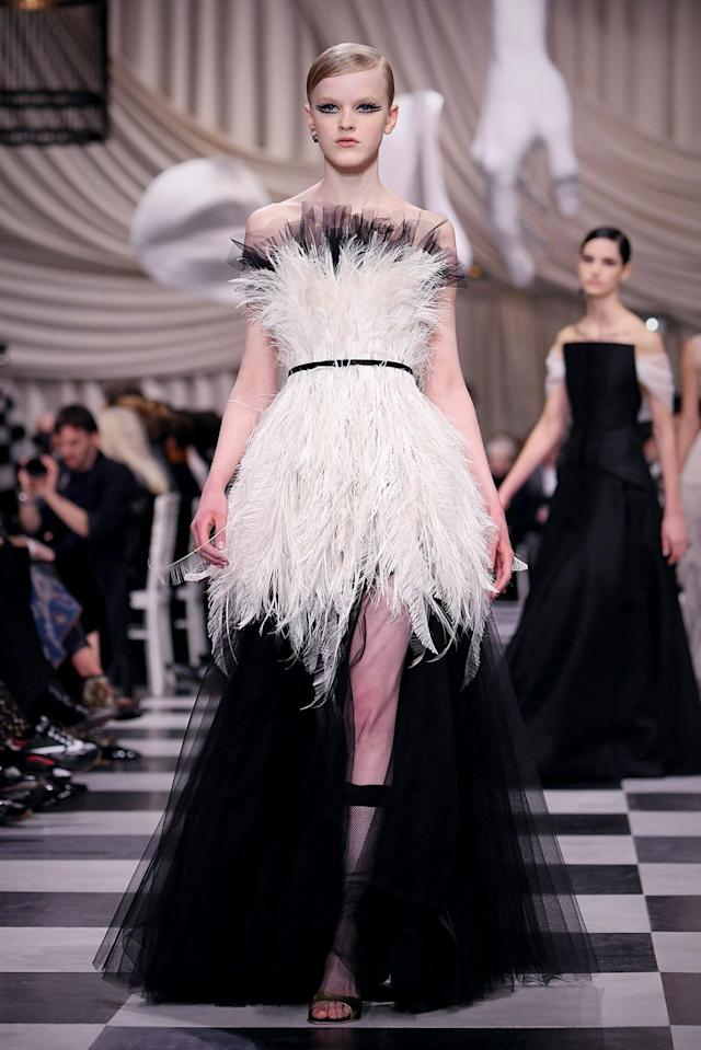 <p>Model wears a white and black feathered bodice gown featuring black tulle, from the Dior SS18 Haute Couture show. (Photo: Getty Images) </p>