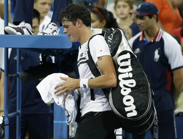 Milos Raonic of Canada walks off the court after losing his match to Richard Gasquet of France at the U.S. Open tennis championships in New York, September 2, 2013. REUTERS/Adam Hunger (UNITED STATES - Tags: SPORT TENNIS)