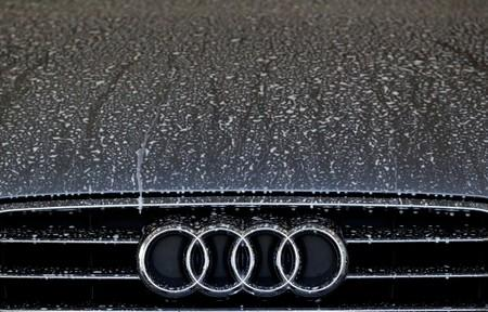 FILE PHOTO: Front of an A6 TDI diesel model of German car manufacturer Audi is pictured  at a car wash in Hanau