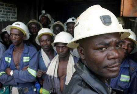 FILE PHOTO: Zambian copper miners wait in a lift before going to work underground in Konkola, Zambia.