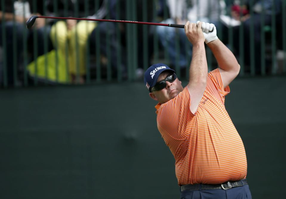 Kevin Stadler hits his tee shot at the 10th hole during the final round of the Phoenix Open golf tournament on Sunday, Feb. 2, 2014, in Scottsdale, Ariz. (AP Photo/Ross D. Franklin)