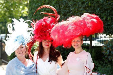 Horse Racing - Royal Ascot - Ascot Racecourse, Ascot, Britain - June 21, 2018 Racegoers pose before the start of the racing Action Images via Reuters/Paul Childs