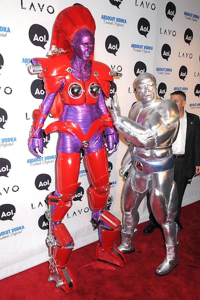"""One day earlier, the fun-loving couple dressed to impress at their annual Halloween party held at Lavo in NYC -- the model disguised herself as an 8-foot red-and-purple alien Transformer, while Seal went as the Silver Surfer. Johns PkI/<a href=""""http://www.splashnewsonline.com/"""" target=""""new"""">Splash News</a> - October 31, 2010"""