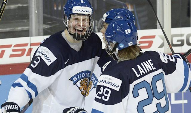 Finland's Jesse Puljujarvi (L to R), Sebastian Aho and Patrik Laine celebrate a goal by Puljujarvi during their 2016 IIHF World Junior Ice Hockey Championship match against Canada in Helsinki, Finland, December 26, 2015. REUTERS/Heikki Saukkomaa/Lehtikuva ATTENTION EDITORS - THIS IMAGE WAS PROVIDED BY A THIRD PARTY. FOR EDITORIAL USE ONLY. NOT FOR SALE FOR MARKETING OR ADVERTISING CAMPAIGNS. THIS PICTURE IS DISTRIBUTED EXACTLY AS RECEIVED BY REUTERS, AS A SERVICE TO CLIENTS. NO THIRD PARTY SALES. NOT FOR USE BY REUTERS THIRD PARTY DISTRIBUTORS. FINLAND OUT. NO COMMERCIAL OR EDITORIAL SALES IN FINLAND.