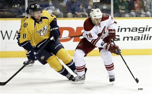 Phoenix Coyotes center Steve Sullivan (26) moves the puck against Nashville Predators defenseman Kevin Klein (8) in the first period of an NHL hockey game on Thursday, March 28, 2013, in Nashville, Tenn. Sullivan is playing in his 1,000th NHL game. (AP Photo/Mark Humphrey)