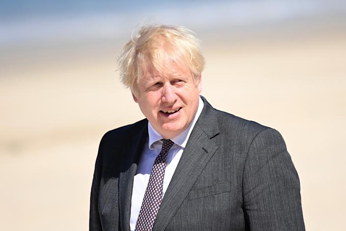 Prime Minister Boris Johnson waits for arrivals during an official welcome of guests, during the G7 summit in Cornwall. Picture date: Saturday June 12, 2021.