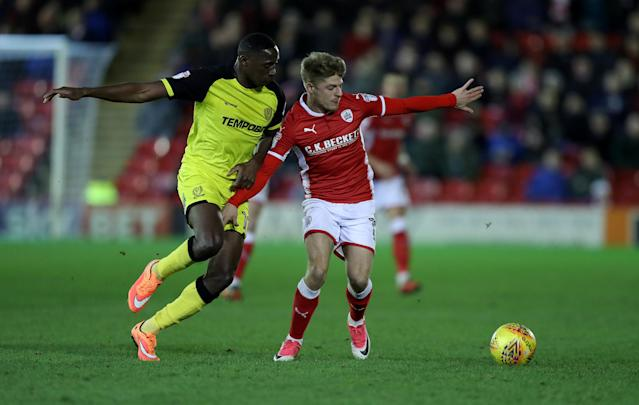 "Soccer Football - Championship - Barnsley vs Burton Albion - Oakwell, Barnsley, Britain - February 20, 2018 BarnsleyÕs Lloyd Isgrove in action with Burton AlbionÕs Lucas Akins Action Images/John Clifton EDITORIAL USE ONLY. No use with unauthorized audio, video, data, fixture lists, club/league logos or ""live"" services. Online in-match use limited to 75 images, no video emulation. No use in betting, games or single club/league/player publications. Please contact your account representative for further details."