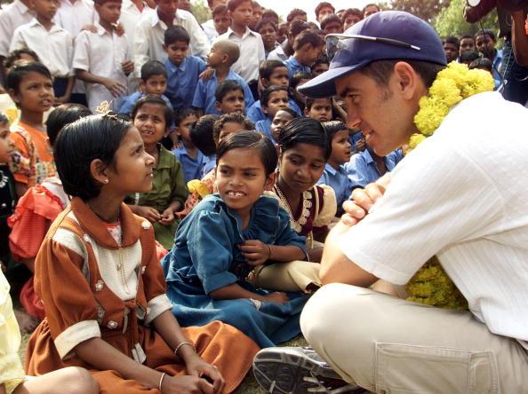 9 Mar 2001:  Justin Langer of Australia meets some of the residents of Udayan Resurection Home, Steve Waugh patroned the girls wing of the home, which educates and cares for the children of Leprosy sufferers, Barrack Pore, Calcuuta, India. X DIGITAL IMAGE  Mandatory Credit: Hamish Blair/ALLSPORT
