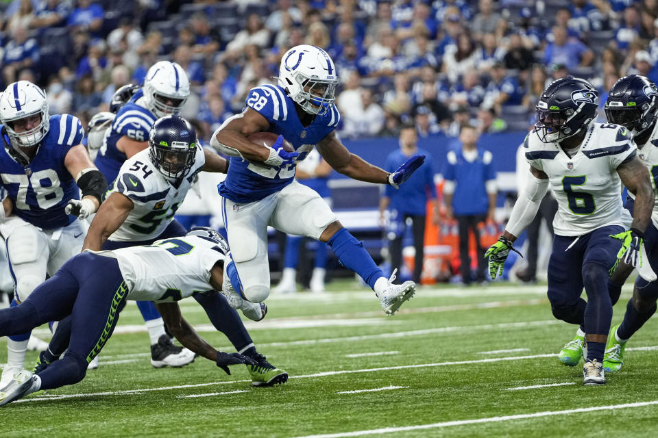 Indianapolis Colts running back Jonathan Taylor (28) leaps over Seattle Seahawks defensive back Marquise Blair (27) during the second half of an NFL football game in Indianapolis, Sunday, Sept. 12, 2021. (AP Photo/AJ Mast)